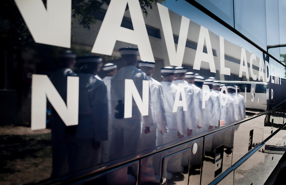 """Incoming midshipmen board a bus to be taken to their dormitory on their first day at the U.S. Naval Academy in Annapolis, MD. Approximately 1,230 young men and women arrived at the U.S. Naval Academy's Alumni Hall, Thursday, July 1, for Induction Day to begin their new lives as """"plebes"""" or midshipmen fourth class (freshmen). """"I-Day"""" culminates when the members of the Class of 2014 take the oath of office at a ceremony at 6 p.m. in Tecumseh Court, the historic courtyard of the Bancroft Hall dormitory. Over 17,400 young men and women applied to be members of the Naval Academy Class of 2014 - a record for USNA."""