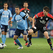 Steve Corica (left) and Matthew Jurman in action during the Sydney FC V Adelaide United A-League match at the Sydney Football Stadium, Sydney, Australia, 27 December 2009. Photo Tim Clayton