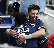 ATLANTA, GA - JUNE 15:  First baseman Eric Hosmer #30 of the San Diego Padres embraces second baseman Jose Pirela #2 after Pirela hit his first home run of the season for 2 RBI in the first inning during the game against the Atlanta Braves at SunTrust Park on June 15, 2018 in Atlanta, Georgia.  (Photo by Mike Zarrilli/Getty Images)