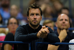 September 2, 2018 - Dieter Kindlmann watches Elise Mertens during her fourth-round match at the 2018 US Open Grand Slam tennis tournament. New York, USA. September 02th, 2018. (Credit Image: © AFP7 via ZUMA Wire)