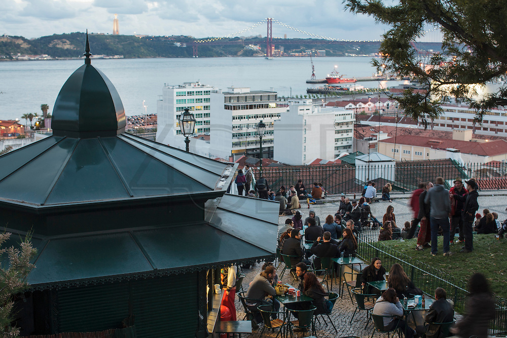 Adamastor lookout in Lisbon gathers many people at sunset time to enjoy the view to Tagus river. Many young people come here with instruments to play music.