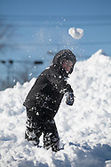 Needham, MA 02/10/2013<br /> Garrett Falahee, age 5, throws a snow ball in the parking lot of Needham High School on Sunday afternoon.