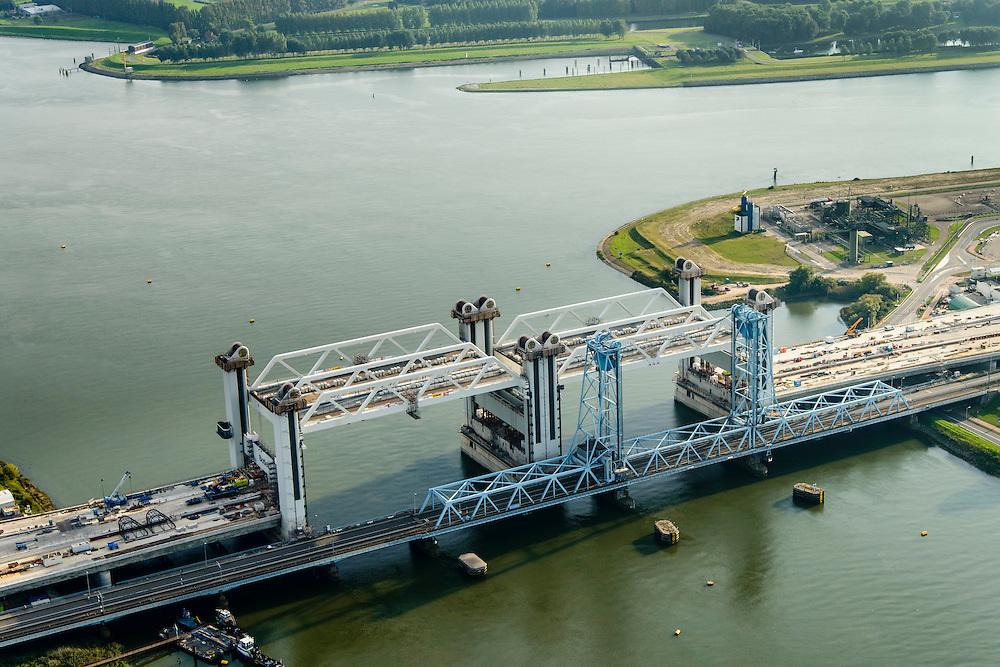 Nederland, Zuid-Holland, Rotterdam, 28-09-2014; Botlekbrug, bouw van de nieuwe gecombineerde spoor- en autowegbrug over de Oude Maas. De nieuwe brug wordt gebouwd door Ballast Nedam naast de bestaande hefbrug.<br /> Botlekbrug, construction of the new combined rail and road bridge over the Oude Maas. The new bridge will be built alongside the existing lift bridge.<br /> luchtfoto (toeslag op standard tarieven);<br /> aerial photo (additional fee required);<br /> copyright foto/photo Siebe Swart.