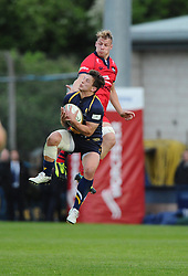 Bristol Rugby Number 8 Mitch Eadie jumps with Worcester Inside Centre Ryan Mills  - Photo mandatory by-line: Joe Meredith/JMP - Mobile: 07966 386802 - 27/05/2015 - SPORT - Rugby - Worcester - Sixways Stadium - Worcester Warriors v Bristol Rugby - Greene King IPA Championship