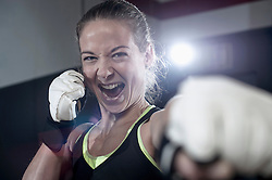 Portrait of a sportswoman in boxing pose in the gym, Bavaria, Germany