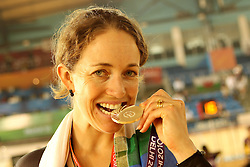 Joanne Kiesanowski of New Zealand celebrates winning the silver medal during the women's scratch race final held at the velodrome at the Indira Gandhi Sports Complex in New Delhi, India on the 7 October 2010..Photo by:  Ron Gaunt/SPORTZPICS/PHOTOSPORT