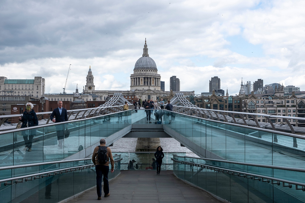 People walking across the Millennium bridge with St Pauls Cathedral in the background on the 25th of May 2021 in London, England. The Millennium bridge is a pedestrian only bridge across the river Thames joining The Tate Modern with St Pauls Cathedral. (photo by Andrew Aitchison / In pictures via Getty Images)