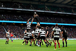 New Zealand's Ardie Savea (top) wins a lineout during the Autumn International match at Twickenham, London.