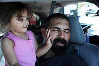 Adalasia is two years-old, and loves to play. The family will move on from the gas station shortly.
