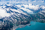Alaska. Whittier, Passage Canal. Nestled in the Chugach Mountains, the port of Whittier has a cruise ship dock being used here by Princess Cruises.