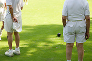 cropped view of elderly people bowling