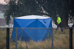 © Licensed to London News Pictures.  19/09/2021. London, UK. Police guard a crime scene in Cator Park in Greenwich, south London following a call at 5:32pm on Saturday 18/09/2021 to the body of a female found near the community centre. A man was arrested several hours later at approximately 9:20pm at an address in Lewisham on suspicion of murder and was taken into custody at a south London police station. Photo credit: Marcin Nowak/LNP