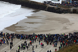 © Licensed to London News Pictures. 11/11/2018. Folkestone, UK. The incoming tide begins to reclaim a giant sand portrait of First World War poet Wilfred Owen is revealed on the beach at Folkestone, Kent during an Armistice Centenary event entitled 'Pages of the Sea'. Portraits are being created by communities on 32 beaches around the UK to say goodbye and thank you, to the millions of men and women who left these shores during the war, many never to return. Lieutenant Wilfred Edward Salter Owen, MC died on 4th November 1918 only days before the Armistice. One of Britain's most celebrated war poets - his short career was directly inspired by the conflict – he composed nearly all his works from August 1917 to September 1918, many published posthumously. Photo credit: Peter Macdiarmid/LNP