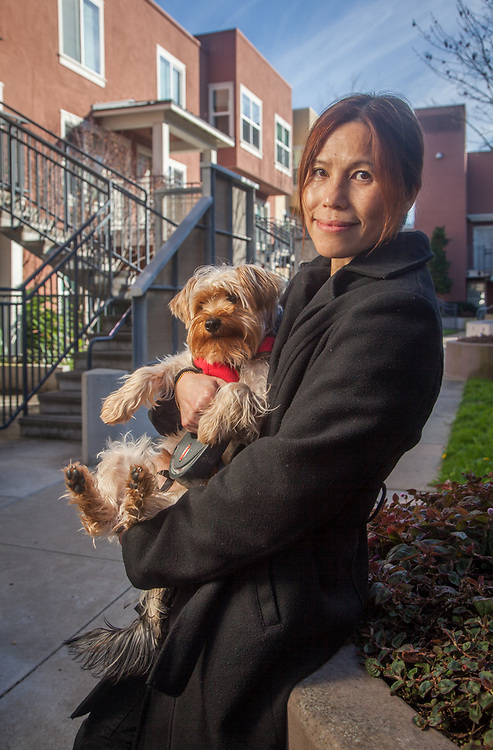 Amy Lai with her dog, Harley, at North Beach Place, San Francisco, CA.  Bridge Housing, San Francisco, Bay area