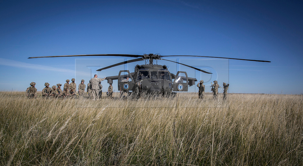 © Licensed to London News Pictures. 08/10/2014.  British Army Training Unit Suffield (BATUS), Canada. Soldiers are introduced and trained on a Blackhawk helicopter as they prepare for Exercise Prairie Storm 3 in Canada.   <br /> <br /> BATUS has been home to the Army for the past 42 years.  It is the only place where all elements of the British Army train together for war.  The soldiers are put to test on everything from armoured vehicles to infantry tactics.        Photo credit : Alison Baskerville/LNP