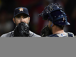 May 16, 2018 - Anaheim, CA, U.S. - ANAHEIM, CA - MAY 16: Houston Astros pitcher Justin Verlander (35) talks with catcher Brian McCann (16) in thew ninth inning of a game against the Los Angeles Angels of Anaheim played on May 16, 2018 at Angel Stadium of Anaheim in Anaheim, CA.(Photo by John Cordes/Icon Sportswire) (Credit Image: © John Cordes/Icon SMI via ZUMA Press)