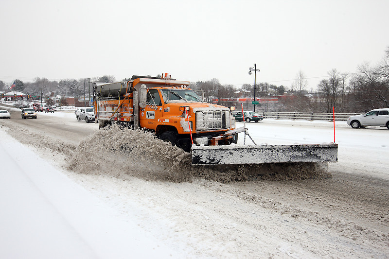 VDOT truck clears snow from Free bridge during an early spring in Charlottesville, VA.