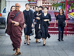 November 3, 2018 - Bangkok, Bangkok, Thailand - A Buddhist monk walks into Wat Debsirin ahead of mourners on the first day of funeral rites for Vichai Srivaddhanaprabha. Vichai was the owner of King Power, a Thai duty free conglomerate, and the Leicester City Club, a British Premier League football (soccer) team. He died in a helicopter crash in the parking lot of the King Power stadium in Leicester after a match on October 27. Vichai was Thailand's 5th richest man. The funeral is expected to last one week. (Credit Image: © Sean Edison/ZUMA Wire)