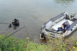 © licensed to London News Pictures. RICHMOND, UK.  01/08/11. Police search the riverbank. The Metropolitan police search the River Thames near Richmond, London, today (1 Aug 2011) after a 17 year boy went missing after taking part in a kayak competition.  Mandatory Credit Stephen Simpson/LNP