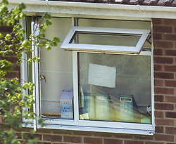 © Licensed to London News Pictures. 20/04/2018. Salisbury, UK. The first floor window at the house of Sergei Skripal is open ahead of the start of cleanup operation in Salisbury. Meerkat soft Toys named Sergie and Oleg rest on the window sill below a pen drawing of a smiling sun face.  Former Russian Spy Sergei Skripal and his daughter Yulia were poisoned using a nerve agent in the city last month. Experts have warned that 'Toxic levels' of the nerve agent novichok could still be present at hot spots around the city. Photo credit: Peter Macdiarmid/LNP