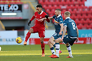 Aberdeen midfielder Funso-King Ojo (8) and Motherwell's Allan Campbell (6) battles for possession, tussles, tackles, challenges, during the Scottish Premiership match between Aberdeen and Motherwell at Pittodrie Stadium, Aberdeen, Scotland on 23 January 2021.