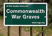 Close of of Commonwealth War Graves sign notice, Orford, Suffolk, England, UK