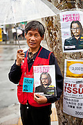 """Portrait of a man selling the magazine """"The Big Issue"""" in the center of Seoul."""