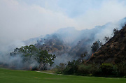 Smoke rises from a brushfire, Sunday, Sept. 3, 2017, in Burbank, Calif. Several hundred firefighters worked to contain a blaze that chewed through brush-covered mountains, prompting evacuation orders for homes in Los Angeles, Burbank and Glendale.(Photo by Ringo Chiu)<br /> <br /> Usage Notes: This content is intended for editorial use only. For other uses, additional clearances may be required.