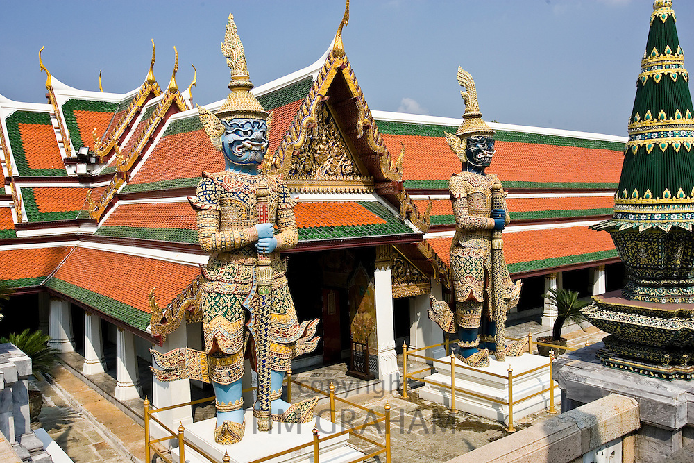 Demon Giant statues guard an entrance to The Grand Palace and Temple Complex, Bangkok, Thailand