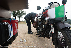 Giuseppe Savoretti of Italy doing roadside repairs on his 1931 Moto Guzzi during Stage 6 of the Motorcycle Cannonball Cross-Country Endurance Run, which on this day ran from Cape Girardeau to Sedalia, MO., USA. Wednesday, September 10, 2014.  Photography ©2014 Michael Lichter.