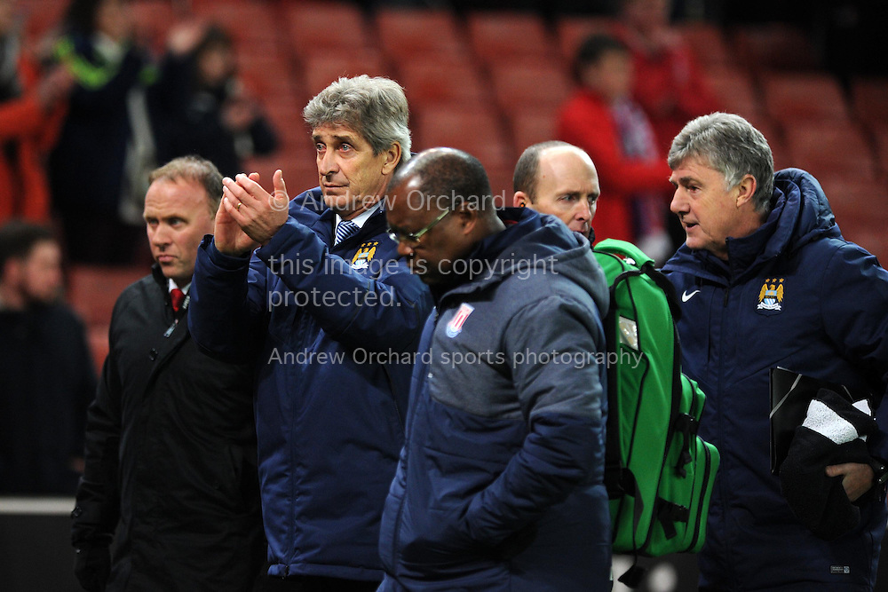 Manchester city manager Manuel Pellegrini © applauds the Man city fans at end of the game. Barclays Premier League match, Stoke city v Manchester city at the Britannia Stadium in Stoke on Trent , Staffs on Wed 11th Feb 2015.<br /> pic by Andrew Orchard, Andrew Orchard sports photography.