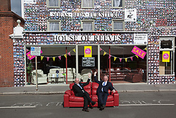 "© licensed to London News Pictures. London, UK 06/08/2012. Maurice (R) and Trevor Reeves, the owners of the House of Reeves furniture store which was burnt down in last year's riots, posing outside their shop. The shop has been covered in 4000 images of young people with positive messages on August 6, 2012 in Croydon. The youth volunteering charity ""vInspired"" are marking the one year anniversary of the riots in Croydon by displaying thousands of images of young Britons holding up positive messages about themselves on the House of Reeves furniture store which was destroyed in last year's violence. Photo credit: Tolga Akmen/LNP"