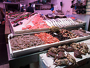 Seafood, shellfish and fish for sale catering for the Carribbean community in Brixton Market, London, UK. Snapper, Bream, Mullet and many other varieties are sold here.