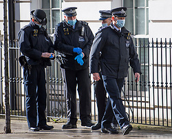 © Licensed to London News Pictures. 13/03/2021. London, UK.  A heavy police presence outside Westminster Magistrates Court where murder suspect Wayne Couzens is due to appear. Couzens, A serving Met Police officer, has been charged with with the kidnap and murder of Sarah Everard, who disappeared as she walked home in Clapham, south London. The body of Sarah Everard was later discovered woodland in Kent more than a week after she was last spotted on 3 March. Photo credit: Ben Cawthra/LNP