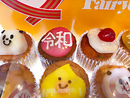 """April 30, 2019, Tokyo, Japan: As Japan enters the Reiwa Era, the Tokyo confectioner Fairycake Fair is offering a ten cupcake """"Baked Reiwa"""" set with various toppings including the Japanese kanji characters for Reiwa (pink w/white kanji), Heisei (yellow w/white kanji) and a cherry top mimicking the Japanese flag. Some are also adorned with gold flakes. The price for this set is ¥3000 ($27). As Japanese Emperor Akihito abdicated the Chrysanthemum Throne, this brought an end to the Heisei Era (Jan. 8, 1989 to Apr. 30, 2019). The new era called 'Reiwa"""" begins May 1, 2019 when Crown Prince Naruhito ascends the throne. The two kanji characters """"'rei"""" and """"wa"""" can be translated as either """"fortunate harmony"""" or """"peace in harmony"""" and were taken from a stanza about plum blossoms in Man'yoshu, a collection of Japanese poetry written sometime after 759. Japanese calendars years are based upon the reigns of it's emperor's."""