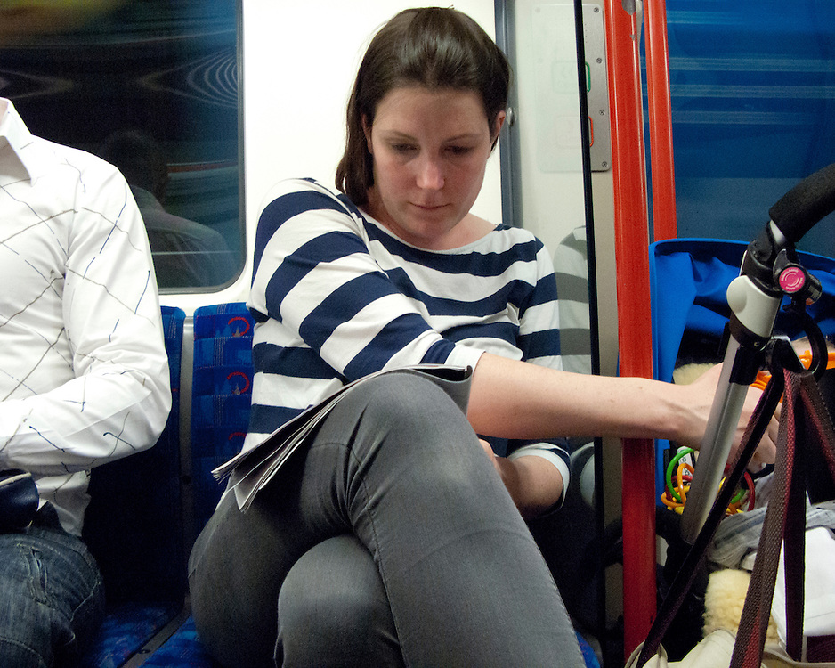 Portrait of a female londoner travelling on the London Underground Network with pram