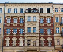 Detail of facade of ornate renovated  old tenement apartment building in Prenzlauer Berg in Berlin, Germany