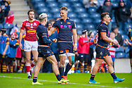 Darcy Graham (#14) is congratulated by Duhan van der Merwe (#11) of Edinburgh Rugby after he scores his first try during the European Rugby Challenge Cup match between Edinburgh Rugby and SU Agen at BT Murrayfield, Edinburgh, Scotland on 18 January 2020.