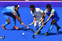 Oct. 15, 2018 - Buenos Aires, Argentina - MANINDER SINGH (L) of India competes during the men's hockey final between Malaysia and India at the 2018 Summer Youth Olympic Games in Buenos Aires, Argentina. Malaysia won 4-2 to claim the title. (Credit Image: © Xinhua via ZUMA Wire)