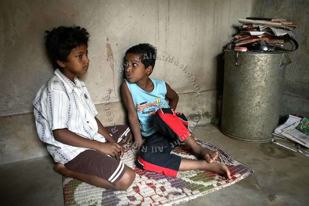 Budhia Singh, (right) 6, the famous Limca World Record marathoner, is sitting in his house with a friend, in Salia Sahi slum (pop. 30.000) of Bhubaneswar, the capital of Orissa State, on Sunday, May 18, 2008. On May 1, 2006, Budhia completed a record breaking 65 km run from Jagannath temple, Puri to Bhubaneswar. He was accompanied by his coach Biranchi Das and by the Central Reserve Police Force (CRPF). On 8th May 2006, a Government statement had ordered that he stopped running. The announcement came after doctors found the boy had high blood pressure and cardiological stress. As of 13th August 2007 Budhia's coach Biranchi Das was arrested by Indian police on suspicion of torture. Singh has accused his coach of beating him and withholding food. Das says Singh's family are making up charges as a result of a few petty rows. On April 13, Biranchi Das was shot dead in Bhubaneswar, in what is believed to be an event unconnected with Budhia, although the police is investigating the case and has made an arrest, a local goon named Raja Archary, which is now in police custody. **Italy and China Out**
