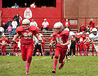 "Donning ""pink socks"" in dedication and to raise funds and awareness for Breast Cancer Research Carter Doherty and Kyle Chiasson make a play for Laconia Middle football against Monadnock Saturday morning.  (Karen Bobotas/for the Laconia Daily Sun)"