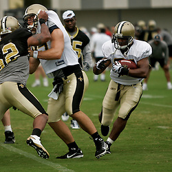 August 3, 2010; Metairie, LA, USA; New Orleans Saints running back Pierre Thomas (23) runs with the ball during a training camp practice at the New Orleans Saints practice facility. Mandatory Credit: Derick E. Hingle