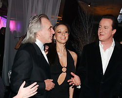 Left to right, PETER STRINGFELLOW, BELLA WRIGHT and Leader of the Conservative Party DAVID CAMERON MP at the Conservative Party's Black & White Ball held at Old Billingsgate, 16 Lower Thames Street, London EC3 on 8th February 2006.<br /> <br /> NON EXCLUSIVE - WORLD RIGHTS