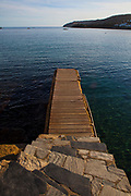 December light falls on the harbour jetty in Cadaqués, Catalonia.