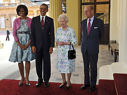President of the United States Barack Obama (second left) and first lady Michelle Obama (left) are greeted by Queen Elizabeth II second right) and The Duke of Edinburgh as they arrive at Buckingham Palace, in central London, on the first day of President Obama's three-day state visit to the UK.