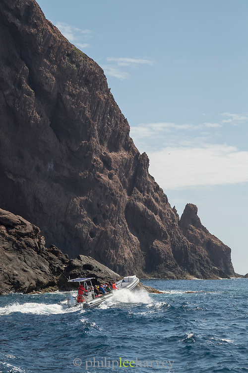 Jet boat on sea speeding near coastline, Scandola Nature Reserve, Corsica, France