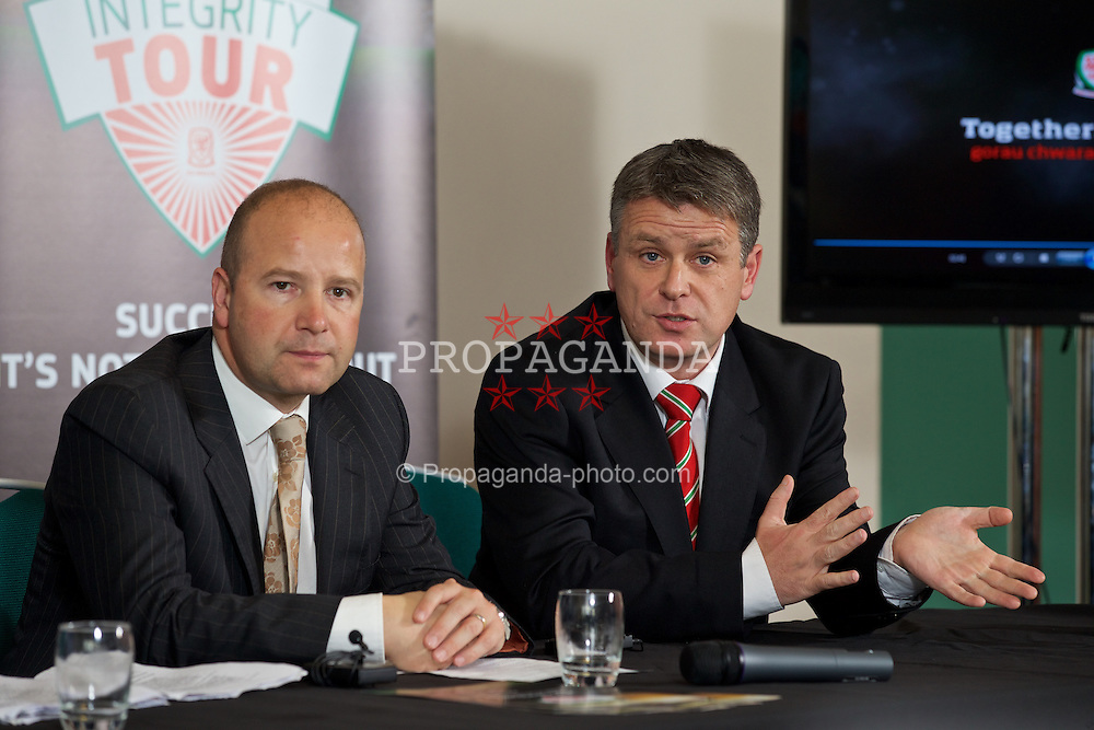 CARDIFF, WALES - Thursday, October 30, 2014: FAW's Chief-Executive Jonathan Ford [R] and Welsh Premier League Secretary Gwyn Derfel at the launch of the FA Wales Integrity Workshop Tour at the St. David's Hotel. (Pic by David Rawcliffe/Propaganda)