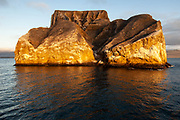 Kicker Rock or León Dormido said to resemble a sleeping lion. It is an eroded tuff cone whose sheer-sided cliffs, cut through the middle are frequented by boobies, frigates and tropic birds. Small boats can pass through thought the narrow sea channel.<br /> Galapagos Islands<br /> ECUADOR.  South America