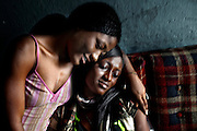 Liberian Girl: Twenty-two-year-old Sophie lives in the old town in Monrovia and dreams of becoming a model.  A single-mother, she has a young daughter to support. Sophie has already appeared in a handful of Liberian magazine and is hoping to move abroad and becoming an international catwalk model, 19 July, 2010.