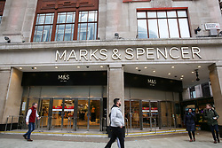 © Licensed to London News Pictures. 10/01/2019. London, UK. Department store chain Marks and Spencer reports a 2.2% fall in like-for-like sales n the 13 weeks to 29 December. Food sales fell 2.1% and its clothing and home sales division slid 2.4%. Shoppers walk past the Marks and Spencer store on Oxford Street. Photo credit: Dinendra Haria/LNP